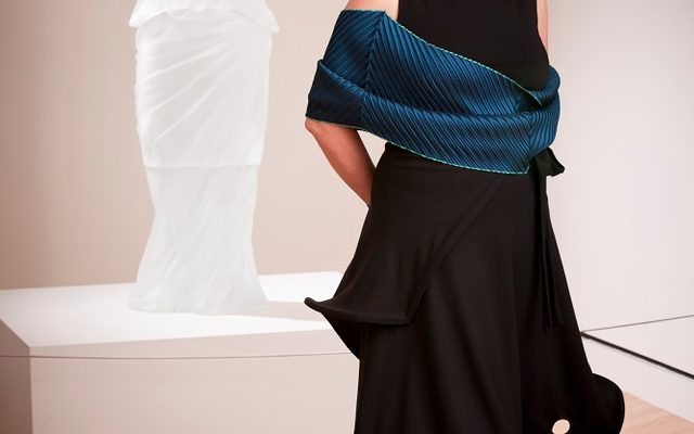 Karen LaMonte with her cast-glass sculpture Dress Impression with Wrinkled Cowl