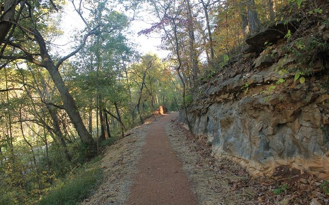 Nature trail cut though layer of limestone to level ground