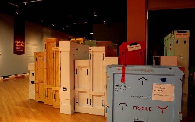 Crates of artwork are lined up in the gallery