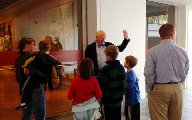 Guide leads a family on a tour of the museum