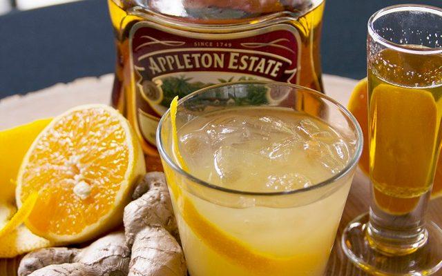 cocktail ingredients rum, ginger, orange and honey