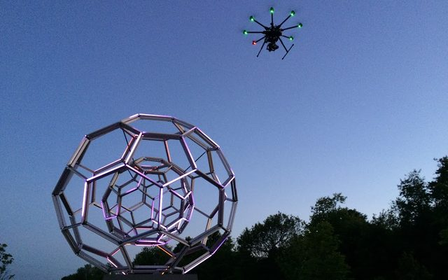 Neon polyhedra and glass-fiber art outdoors