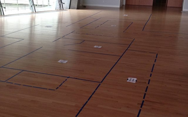 Floor plan taped out on a wooden floor