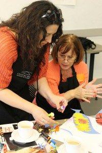 Participants work with a variety of art-making materials.