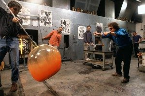 Dale Chihuly (right) directs studio artists in the creation of one of his distinctive glass sculptures.