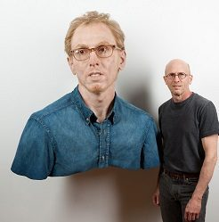 Evan Penny, Young Self, Variation #3 (with artist), 2011. Silicone, pigment, hair, fabric, aluminum, 86 x 76 x 59 cm. Art and image © Evan Penny.
