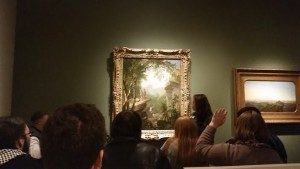 Launch students participate in a gallery discussion of Asher B. Durand's painting Kindred Spirits.