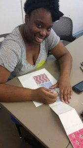 A Launch participant working on her accordion book project in one of Crystal Bridges' studios.