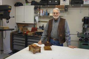 Crystal Bridges volunteer and woodcrafter Myron Williams in his workshop.