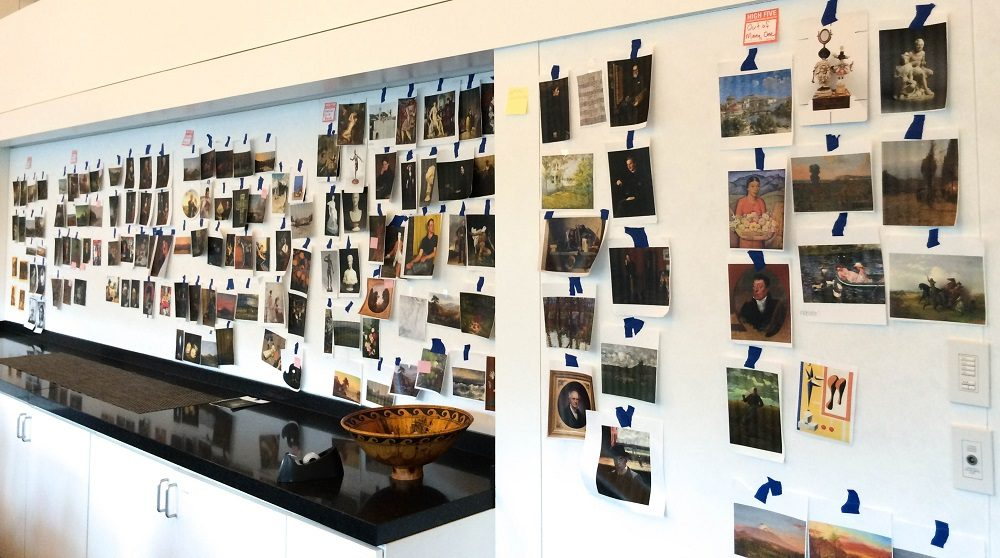 Walls in the Museum's Curatorial offices are covered with printed images of every work in Crystal Bridges' Colonial and Early Nineteenth Century Gallery, as the exhibition and interpretation teams work out how they want the works to be grouped in the final gallery layout.