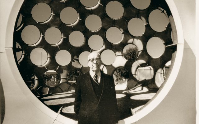 Buckminster Fuller in front of a Fuller dome