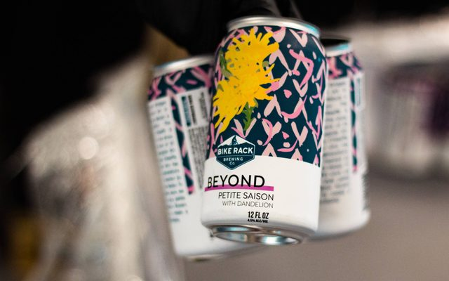 Cans of Beyond Petite Saison beer