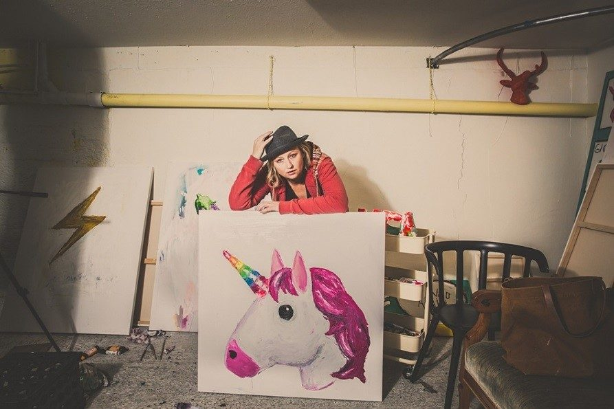Kat Wilson pictured above in Self-portrait with Unicorn Emoji Painting, 2018