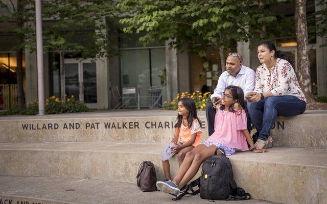 Family sitting on Walker Landing
