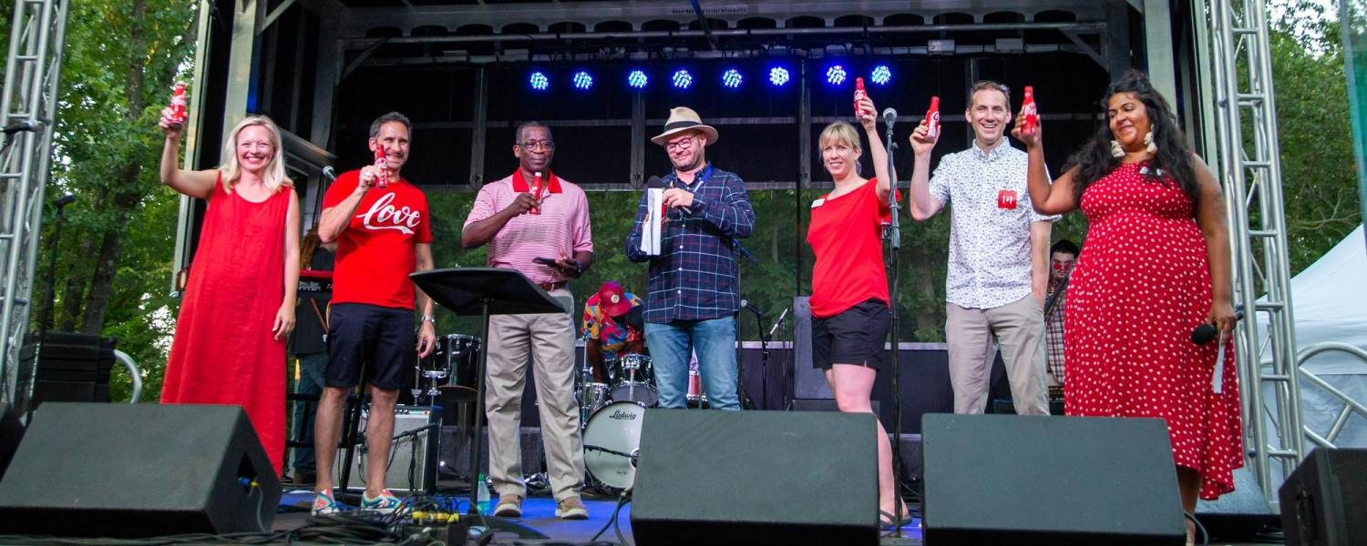 """<a href=""""https://themomentary.org/coca-cola-announced-as-a-founding-funder-of-the-momentary/""""></a> Coca-Cola is announced as a Founding Funder of the Momentary on the Forest Concert Stage in summer 2019. Learn more at theMomentary.org."""