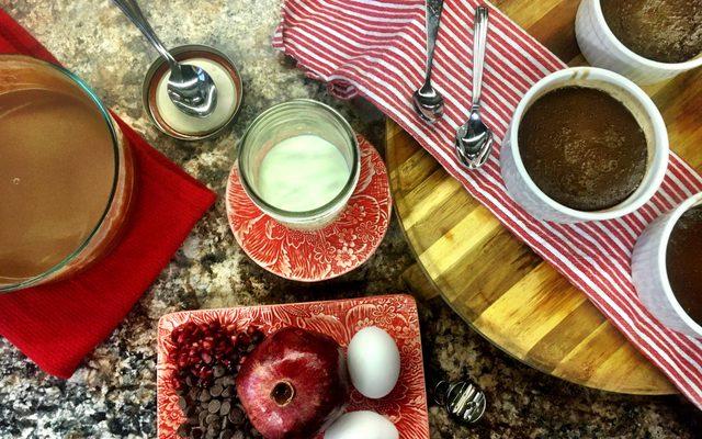 various food ingredients in bowls with spoons