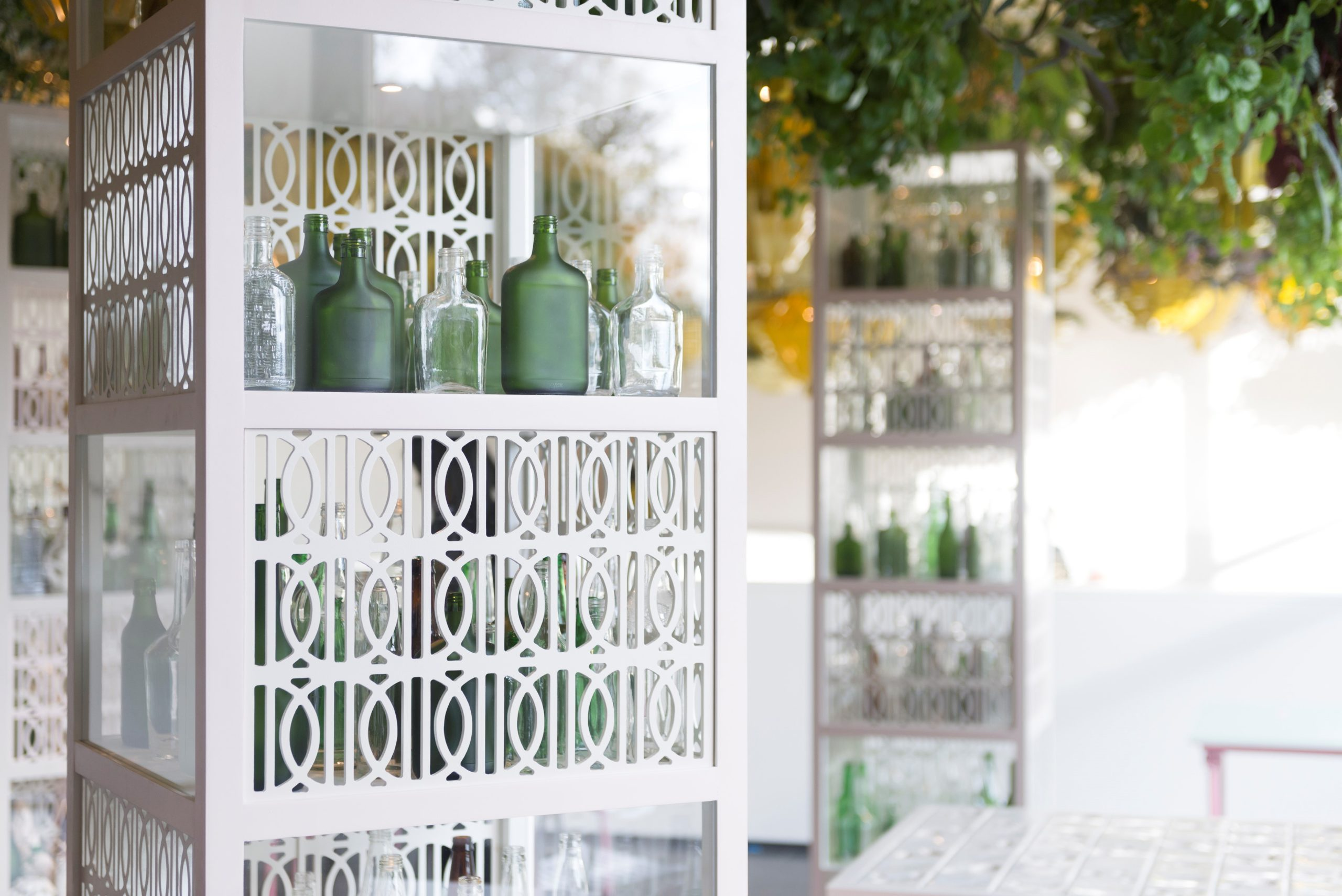 Open 24 Hours, 2017, Found glass bottles of liquor, display cabinets, 8 × 2 × 2 ft. each, Display cabinets co-designed by Navillus Woodworks, Courtesy of the artist.