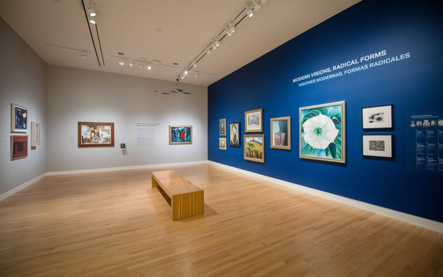 View of a gallery with artwork hung on the wall