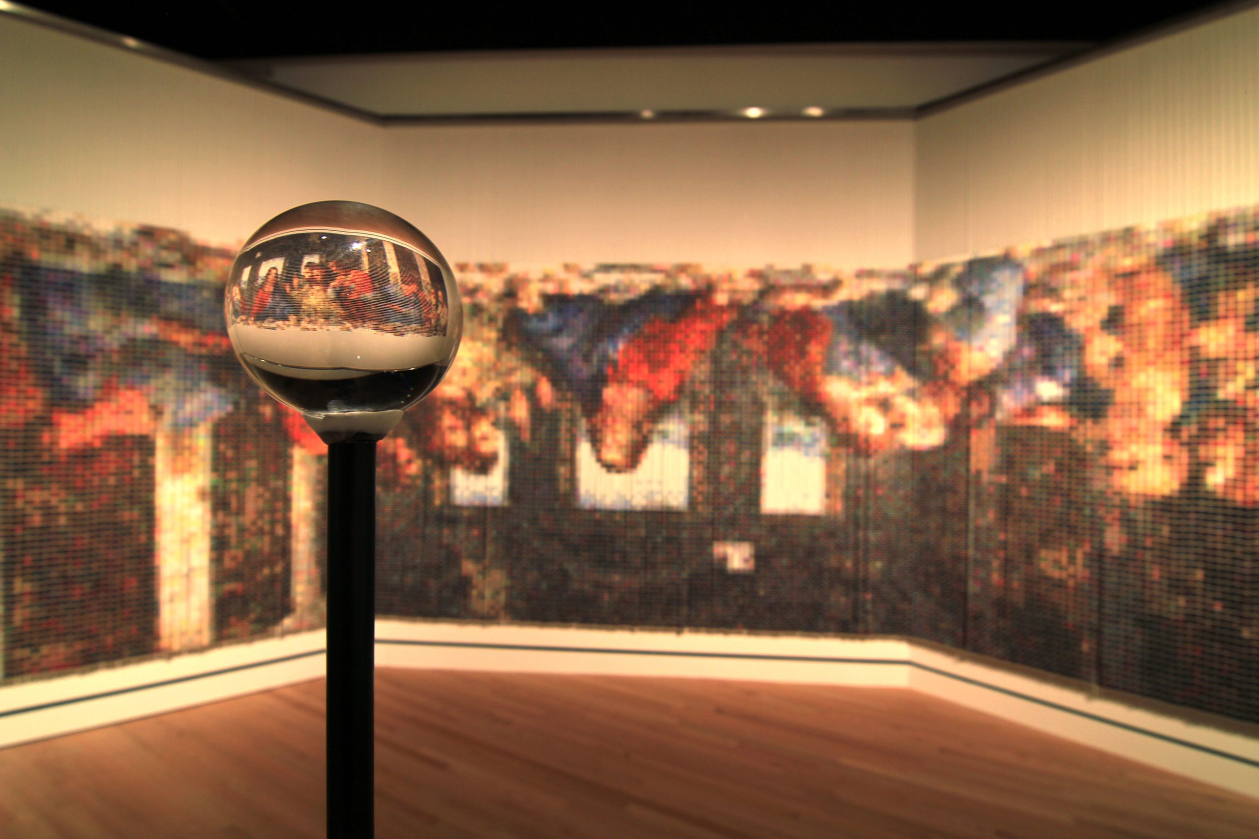Devorah Sperber, After The Last Supper, 2005, 84 1/2 x 348 x 108 in. (214.6 x 883.9 x 274.3 cm), 20,736 thread spools, hanging apparatus, ball chain, viewing sphere, and stand, Crystal Bridges Museum of American Art.