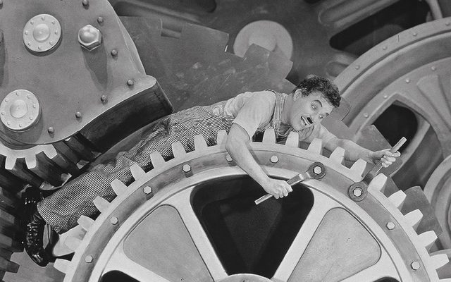 Chaplin in one of the most famous and memorable scenes from Modern Times