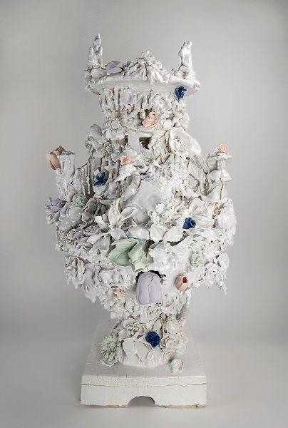 Anthony Sonnenberg, Campagna Vase (Drama Kween), 2018, porcelain over stoneware and found porcelain tchotchkes, and unglazed color, 32 in. × 9 1/2 in. × 9 1/2 in. (81.3 × 24.1 × 24.1 cm), courtesy of Anthony Sonnenberg.