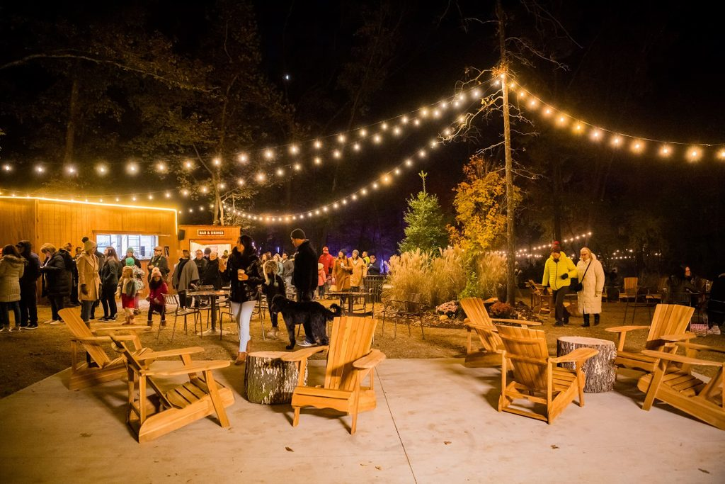 Outdoor pavilion at night with people