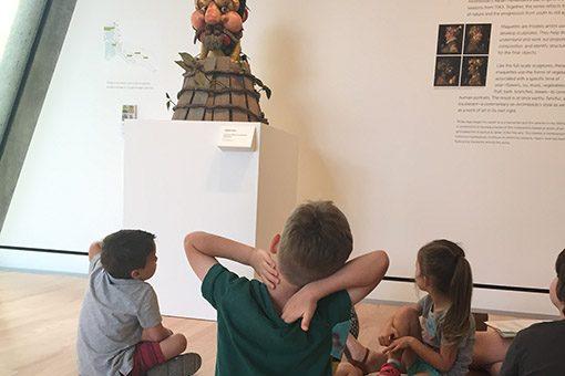 Children in museum looking at sculpture