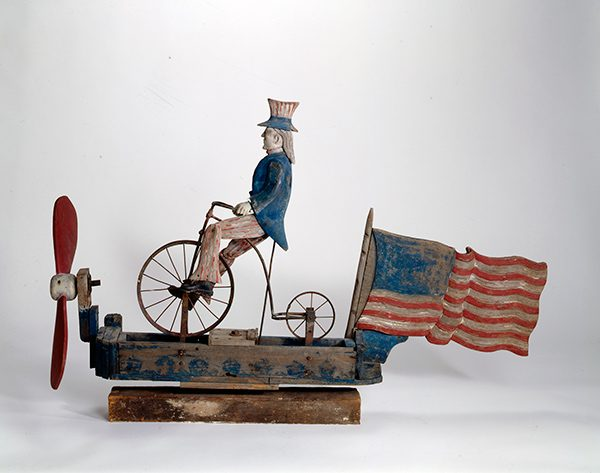 Sculpture of Uncle Sam riding bicycle