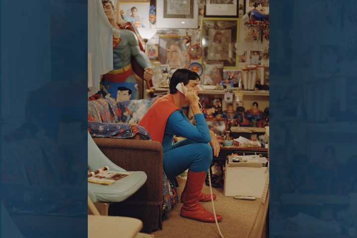 Photo of Christopher Reeve as Superman on telephone