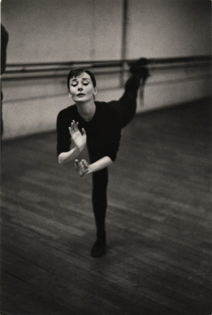 """Chim (David Seymour), Audrey Hepburn in ballet position, rehearsing for the film """"Funny Face,"""" 1956"""