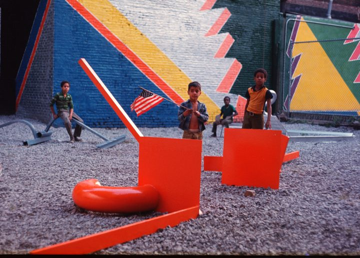 Children outdoors with metal sculpture