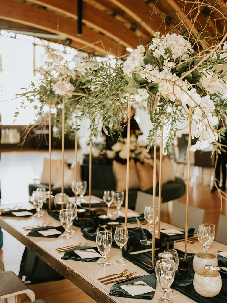banquet tables with place settings and fresh flower arraignments