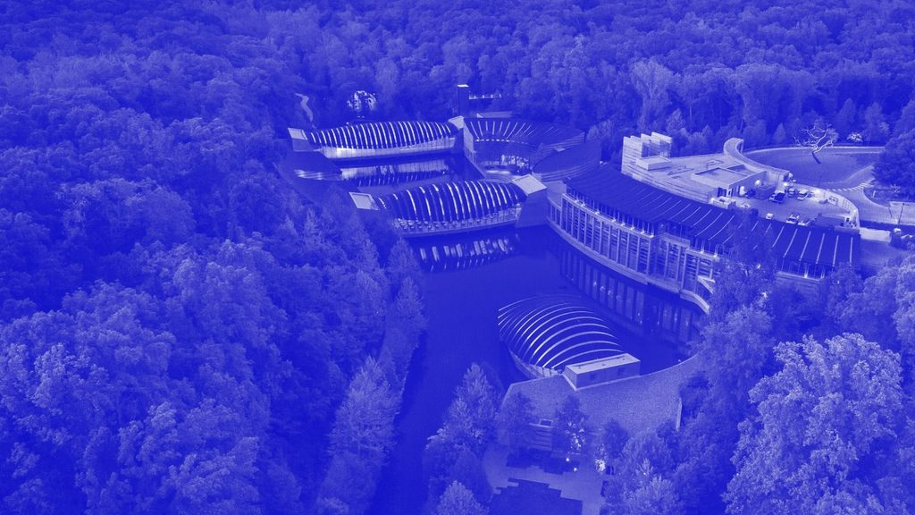 Aerial view of Crystal Bridges campus with blue tint