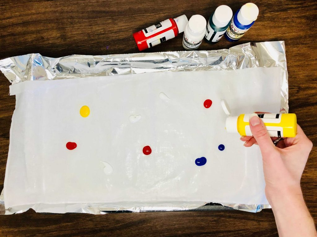 Small blobs of acrylic paint all over a canvas