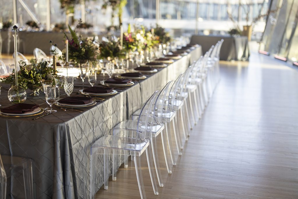 Long table with chairs and place settings