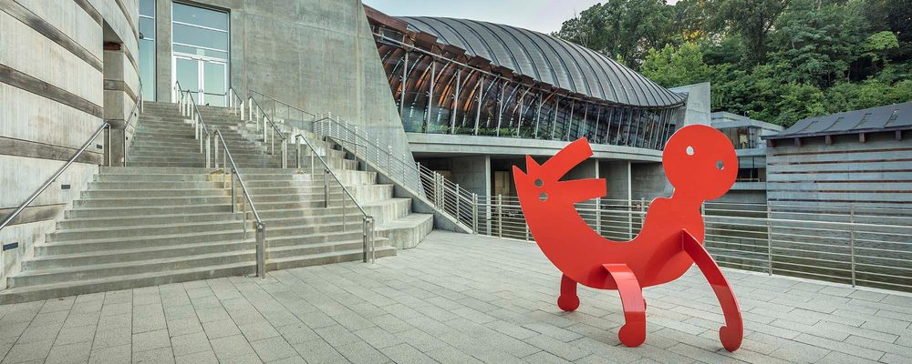 Walker Landing with Two Headed Figure sculpture by Keith Haring