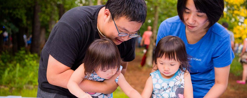family at an outdoor event on Crystal Bridges grounds