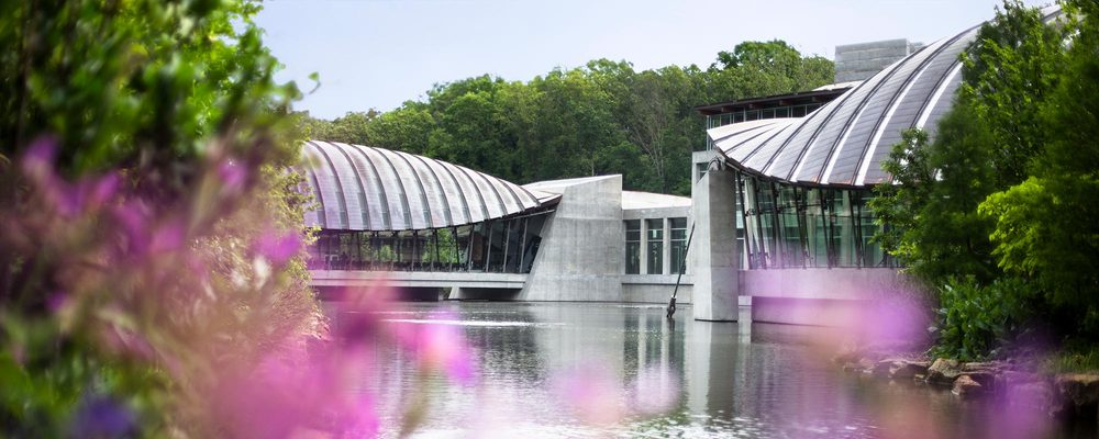 Crystal Bridges architecture with blooming redbuds