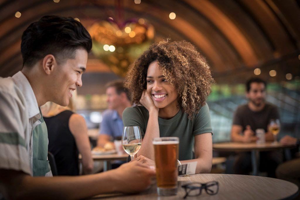 People enjoying beverages at Eleven restaurant