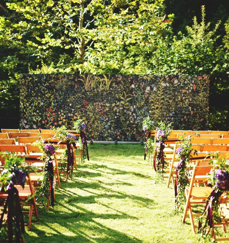Wooden chairs arranged on lawn