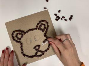 Hands making artwork