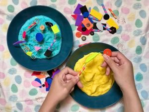 Hands forming salt dough landscape