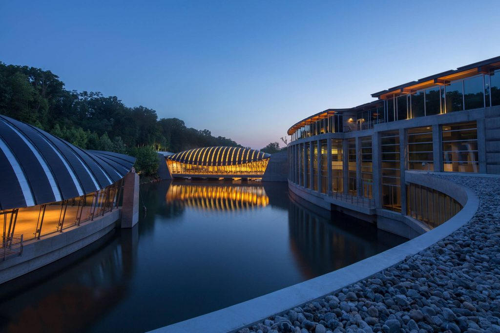 Crystal Bridges at dusk with water