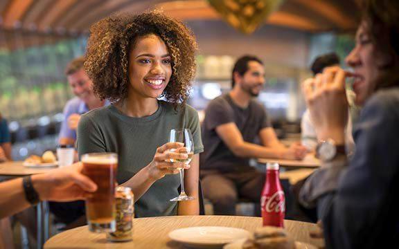 Visitors enjoying beverages in the Eleven restaurant