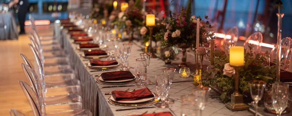 Long table with place settings and chairs