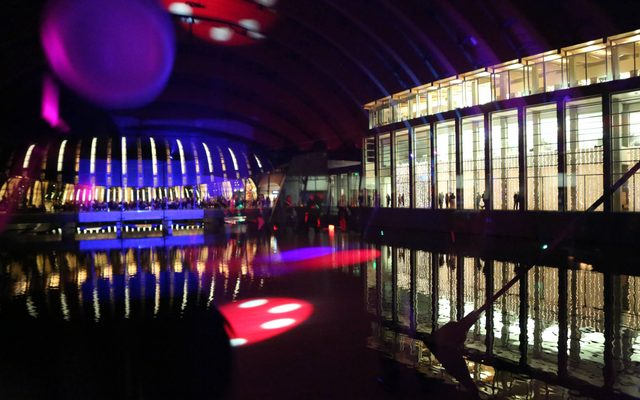 Museum exterior at night with colored lights
