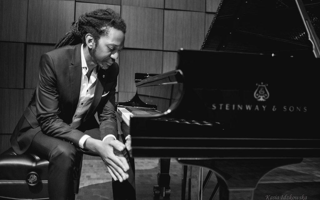 Elio Villafranca sitting in front of a piano