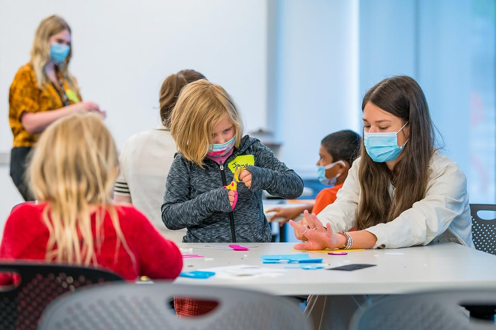 Kids doing arts and crafts with masks