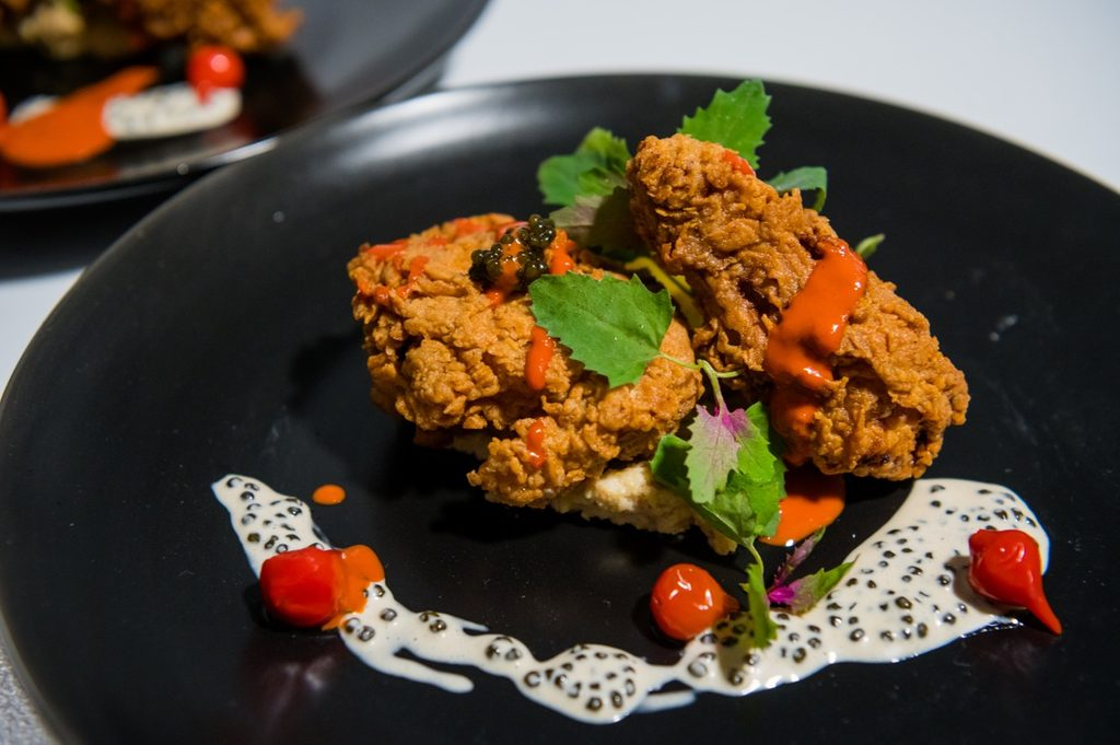Close up of fried chicken with herbs and spices