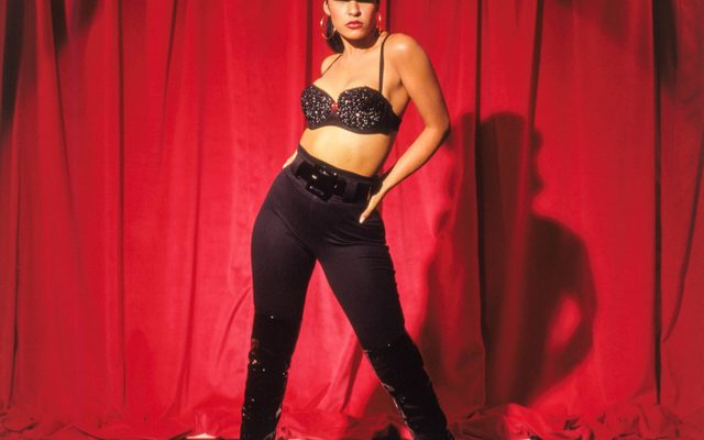 image of selena with a red backdrop and checkerboard floor